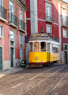 The historic yellow 28E tram line in the Alfama district of Lisbon, Portugal