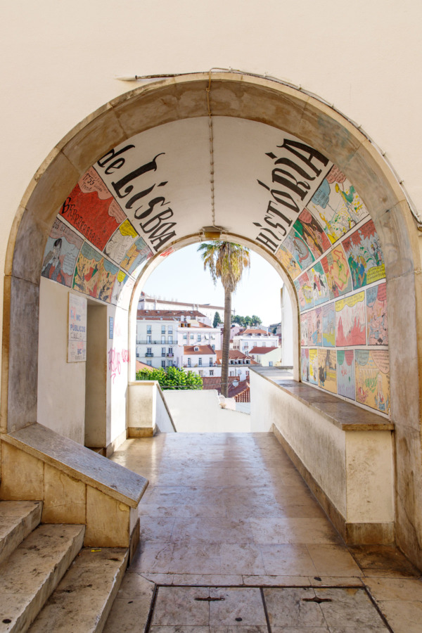 Colorful wall art decorating a tunnel in the Alfama district, Lisbon, Portugal