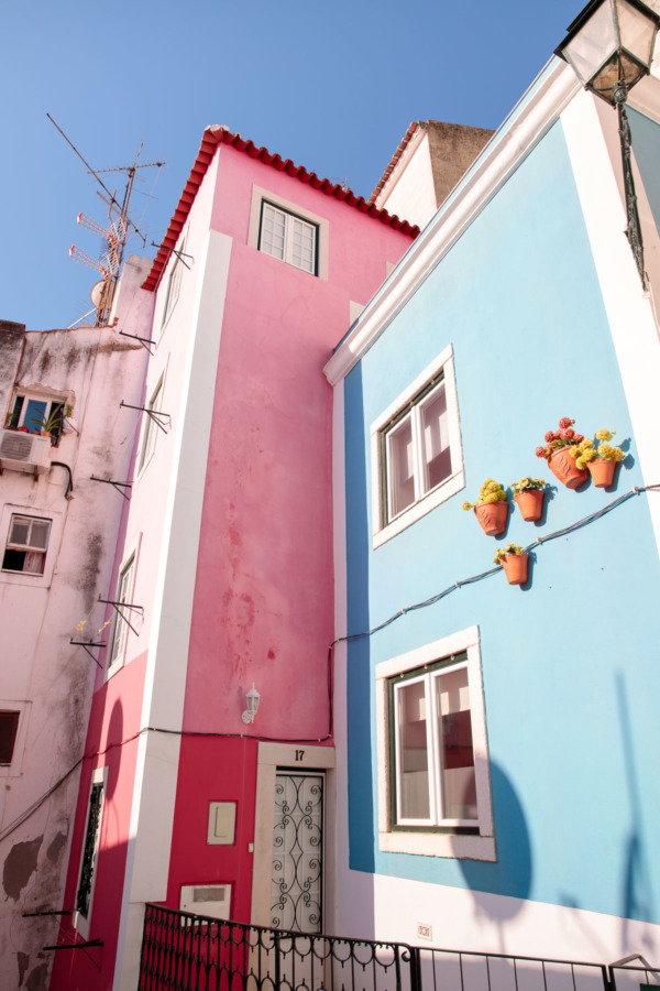 Colorful pink and blue buildings in the Alfama district of Lisbon, Portugal