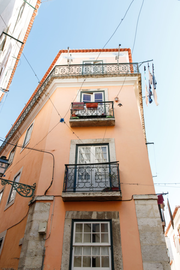 Colorful orange building in the Alfama district of Lisbon, Portugal