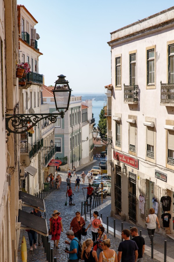Looking down a hilly street in Lisbon, Portugal