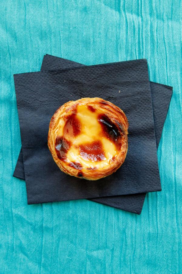 A freshly baked Pastéis de Nata from Fábrica da Nata in Lisbon, Portugal