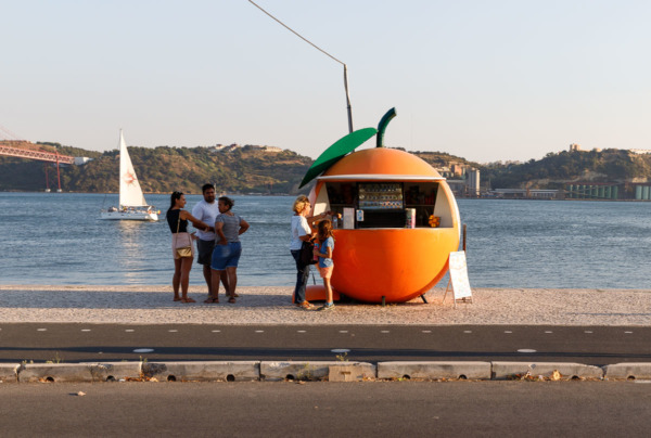 Cute orange-shaped juice stand along the Tagus river in Lisbon, Portugal