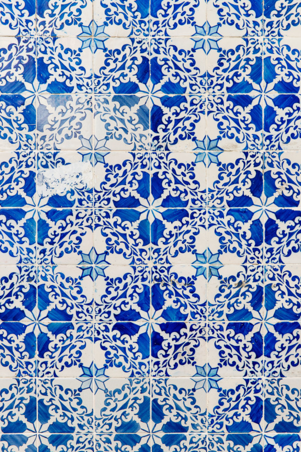 Blue and white floral tile design on a building in Lisbon, Portugal