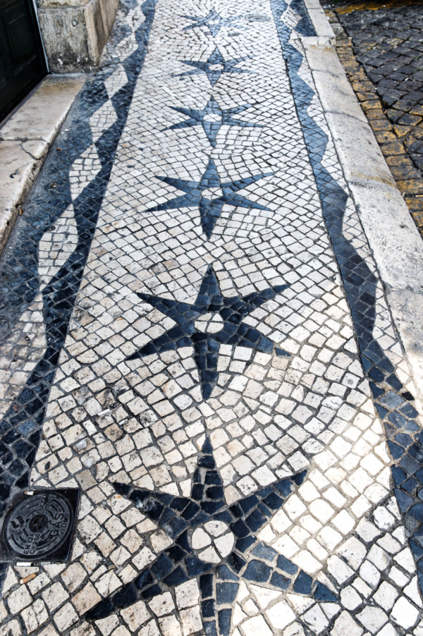 Black and white star design mosaic sidewalks in Lisbon, Portugal