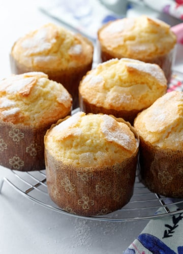 A wire cooling rack with freshly baked rice muffins on top