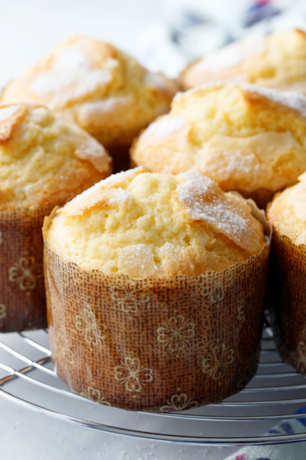 Closeup of freshly baked rice muffins, showing the crackly sugar topping.