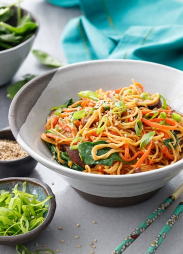 Bowl of Sesame Stir Fry Noodles with Mushrooms, Carrots and Spinach