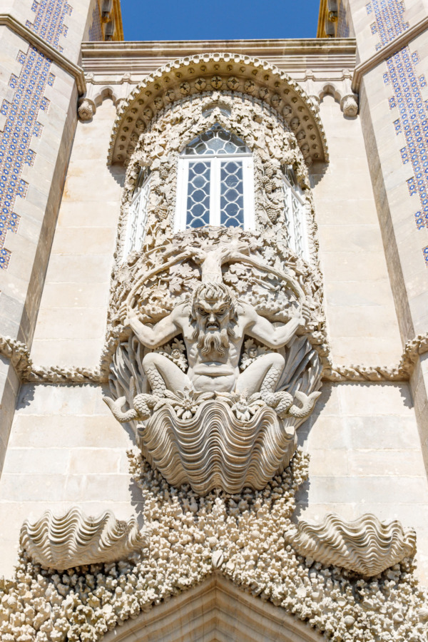 Stone carvings over an archway of the Pena Palace, Sintra, Portugal