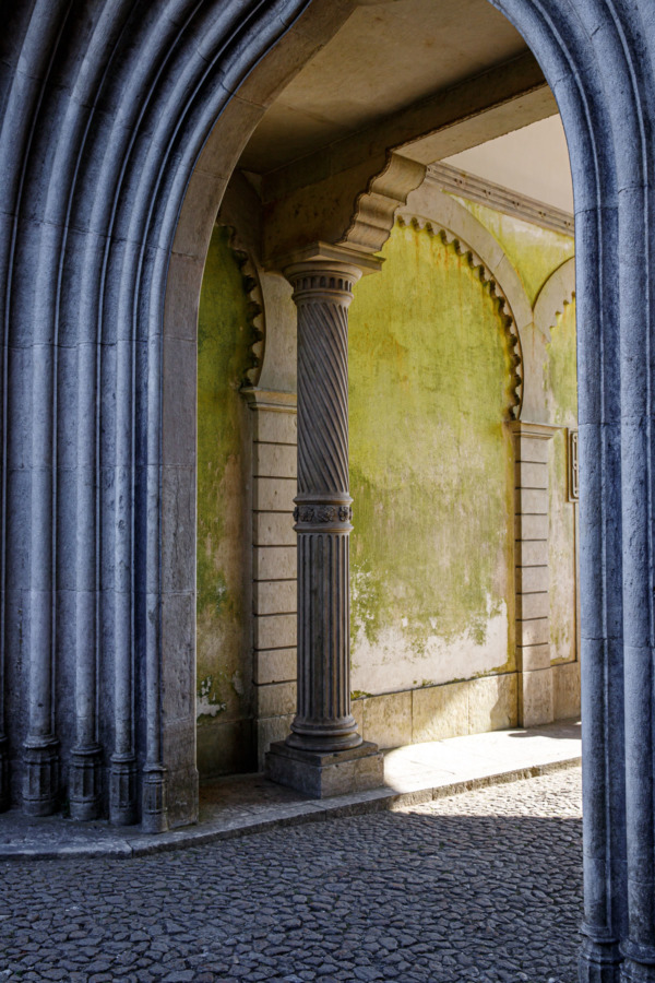 Light coming through an archway in the Pena Palace, Sintra, Portugal