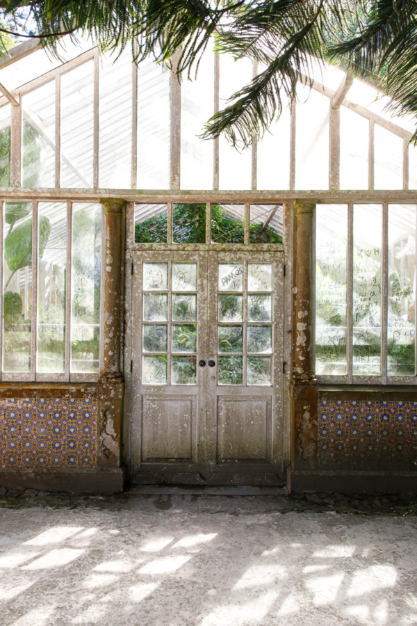 The greenhouse in the Pena park, with dusty windows filled with scrawled names.