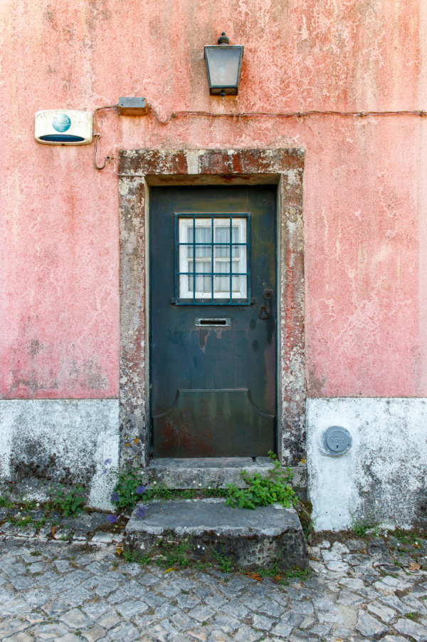 Pastel pink walls with a dark green door, Sintra, Portugal