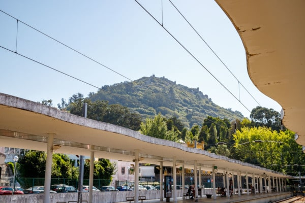 The train station in Sintra, Portugal with the castle of the Moors on the hill in the background.