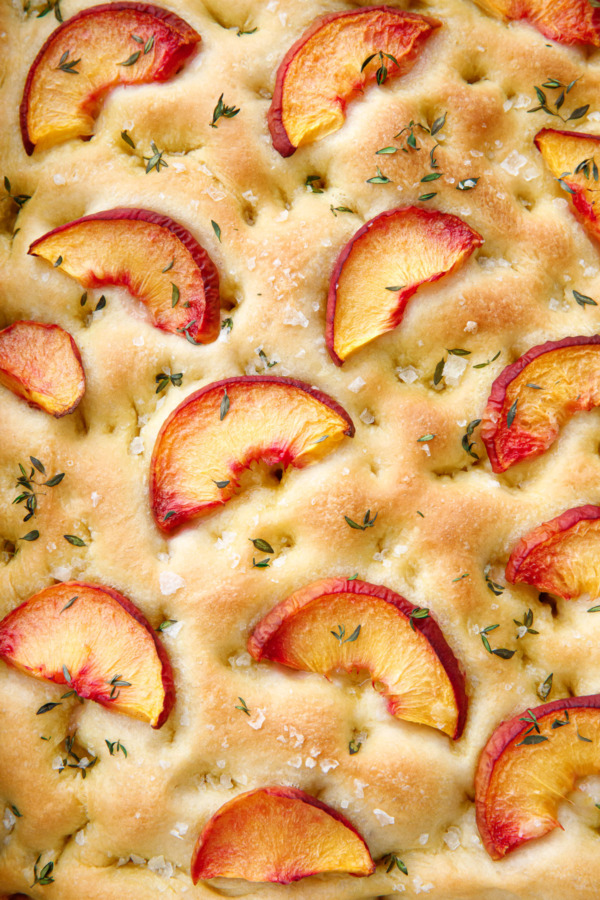 Closeup of the topping of Peach & Fresh Herb Focaccia Bread