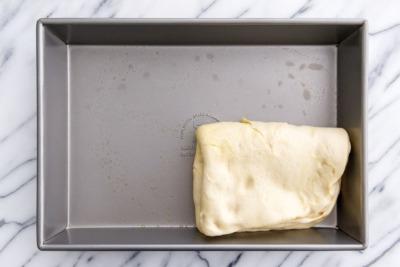 How to make homemade focaccia bread: fold dough in half again.