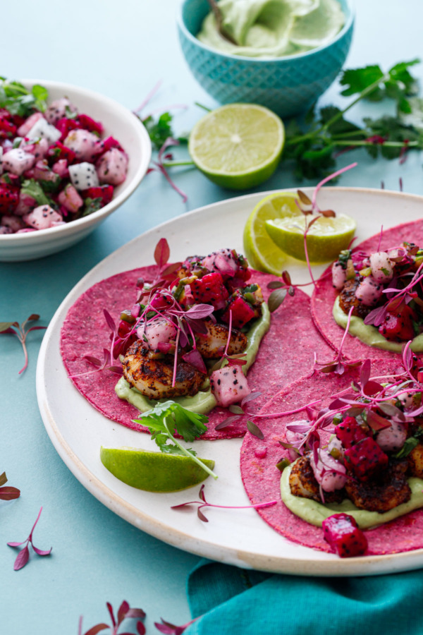 Blackened Shrimp Tacos with Dragonfruit Salsa on pink colored tortillas