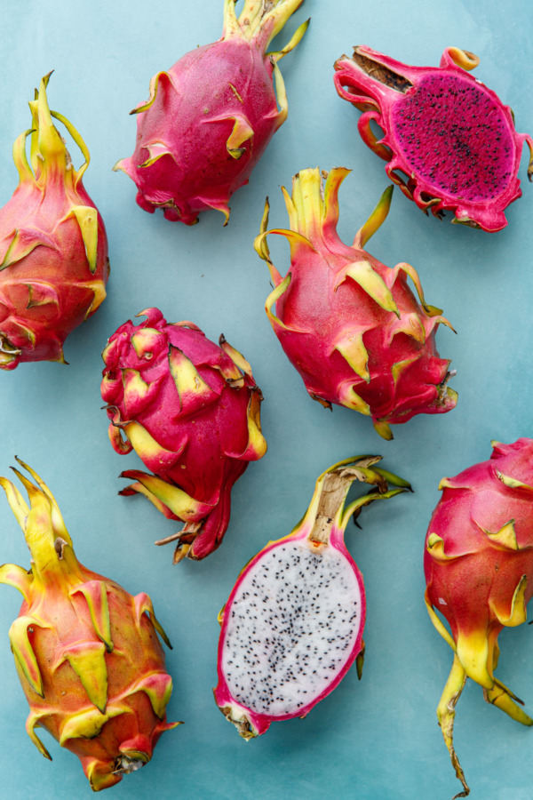 Pink and white dragonfruit on a turquoise background