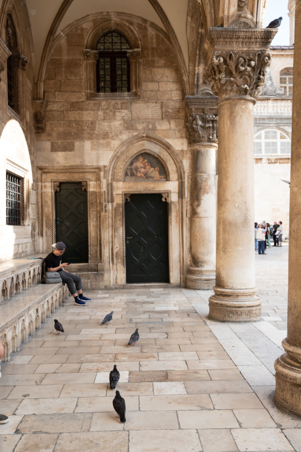 Portico with Tourist and Pigeons, Old Town Dubrovnik, Croatia
