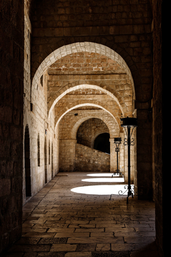 Light streaming through archways inside Fort Lovrijenac in Dubrovnik, Croatia