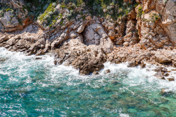 Rocky beach and turquoise waters, Dubrovnik, Croatia