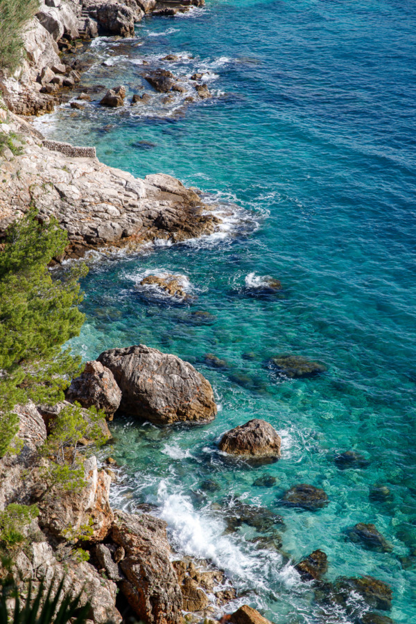 Beautiful turquoise waters along a rocky coastline, Dubrovnik, Croatia