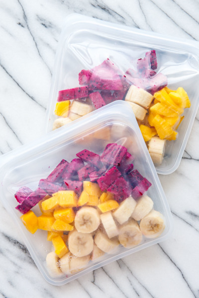 Store portioned frozen fruit in reusable silicone bags - just dump in the blender, add liquid and blend!