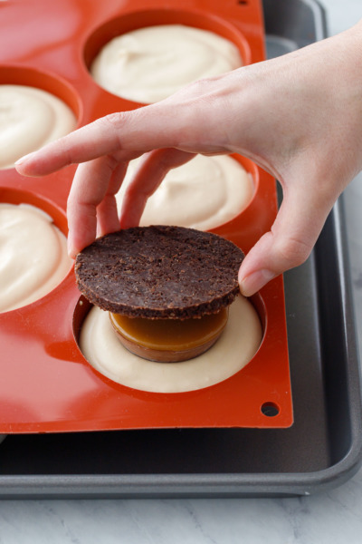 How-To Entremet Cake Process: place a round of chocolate pecan crust on top.
