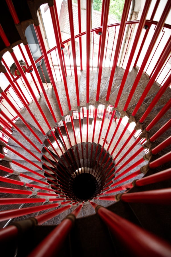 Red double spiral staircase leading up to the castle tower in Ljubljana, Slovenia