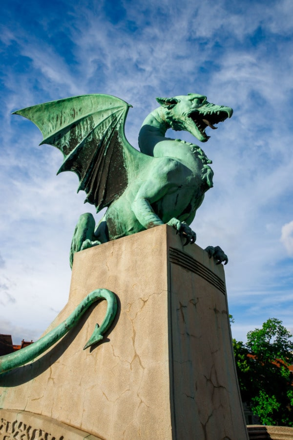 Green patina dragon statue guarding the Dragon's Bridge in Ljubljana, Slovenia