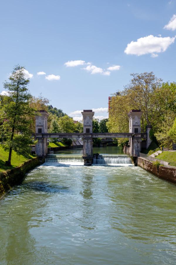 Ljubljanica River in Ljubljana, Slovenia and a Sluice Gate and Triumphal Arch designed by Jože Plečnik