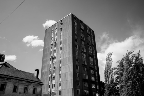 Black and white photo of stark industrial apartment building, Ljubljana, Slovenia
