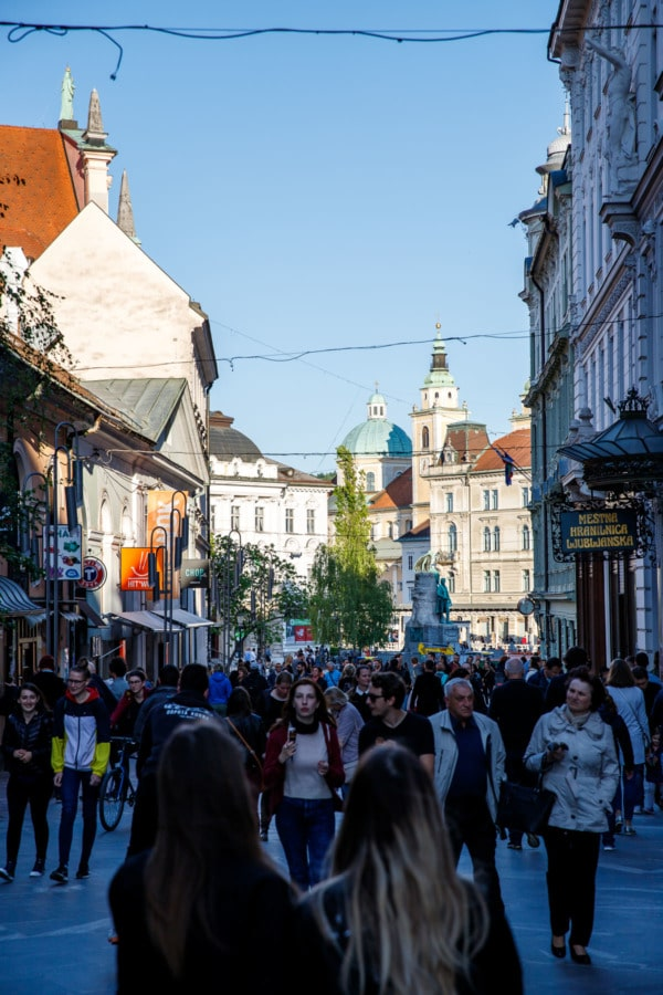 Busy street filled with people in Ljubljana, Slovenia
