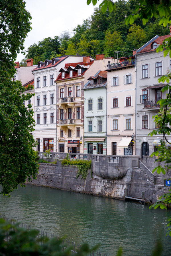 Pastel buildings along the river in Ljubljana, Slovenia