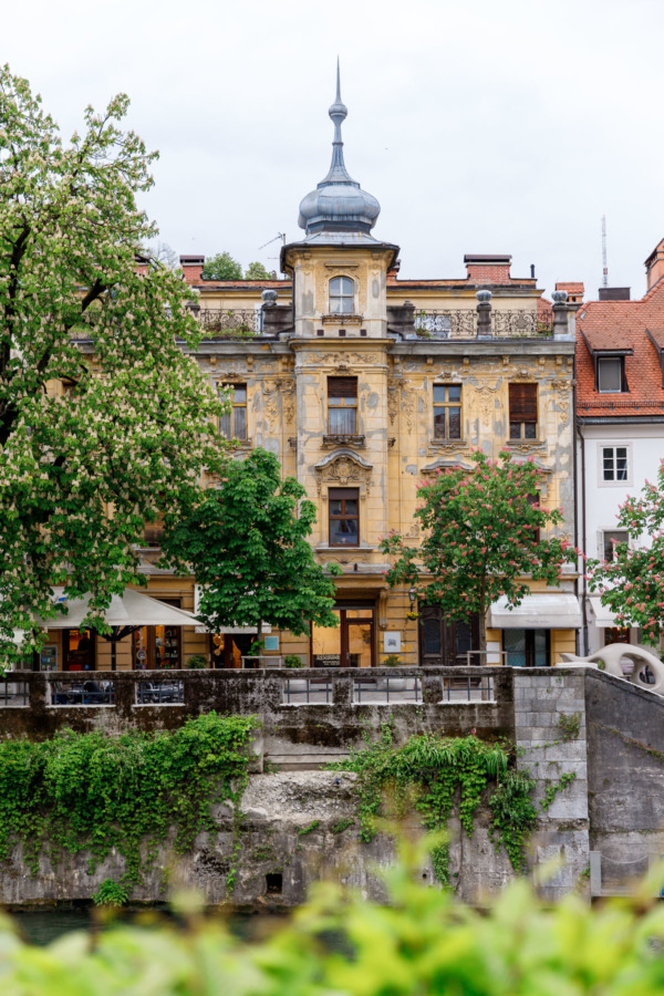 Pastel buildings along the river in Ljubljana, Slovenia