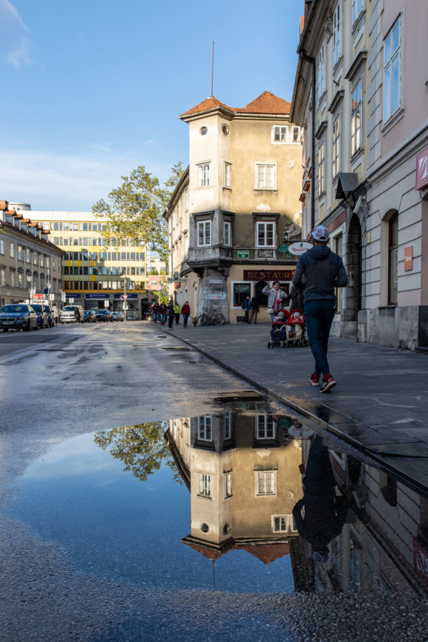 Reflection in a puddle on a street in Ljubljana, Slovenia