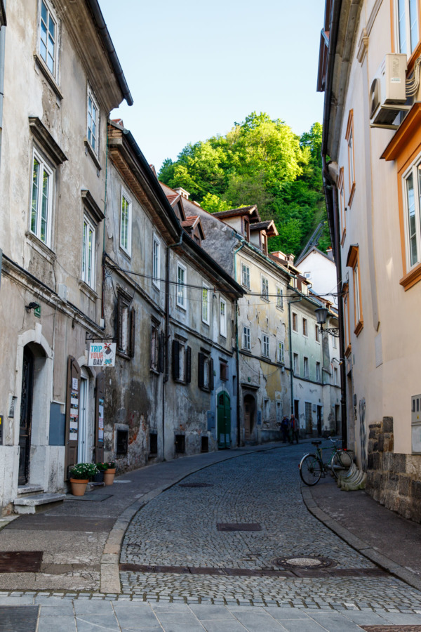 Narrow cobbled street lined with buildings in Ljubljana, Slovenia