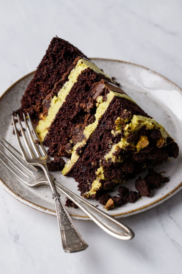 Closeup slice of Dark Chocolate Pistachio Naked Layer Cake