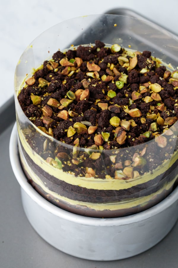 The finished Chocolate Pistachio Naked Layer Cake, still wrapped in acetate. Now refrigerate until set.