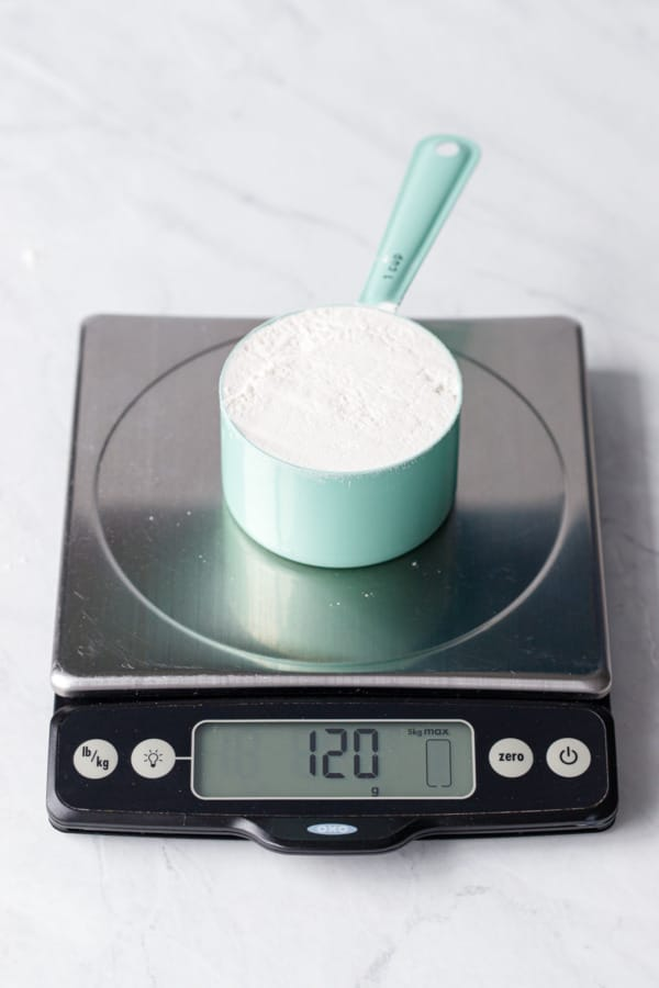 1 cup of flour measured using the spoon and sweep method weighs 120 grams.