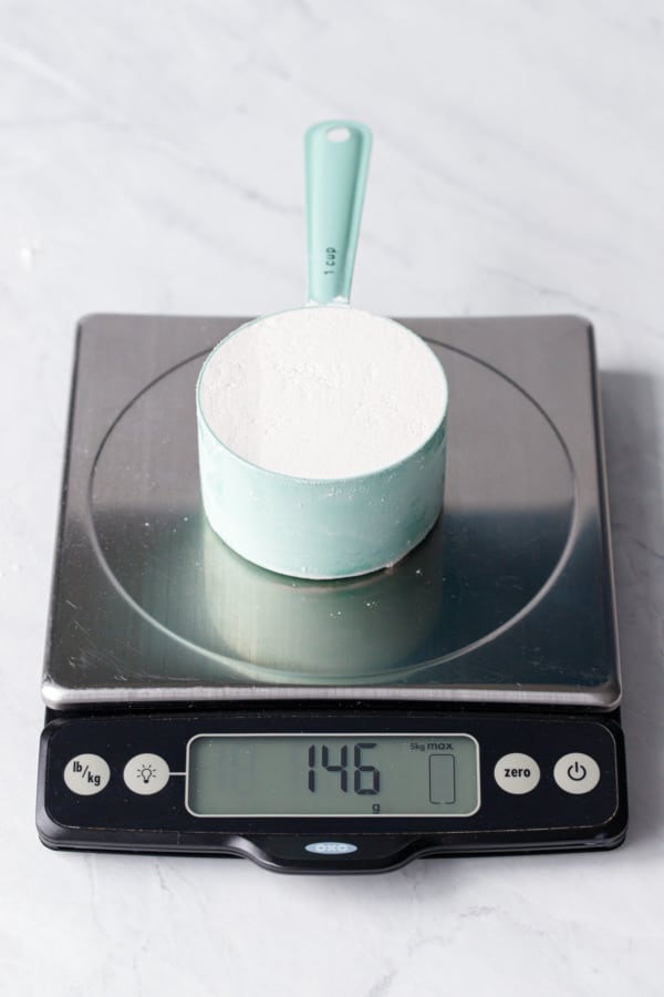 1 cup of flour scooped right out of the bag weighs 146 grams.