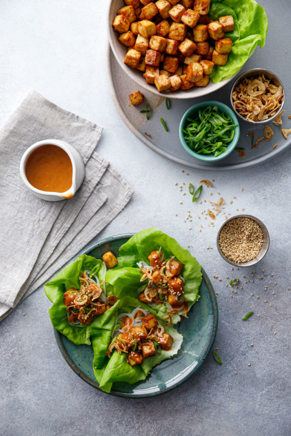 Overhead scene Baked Tofu Lettuce Wraps with Spicy Peanut Sauce