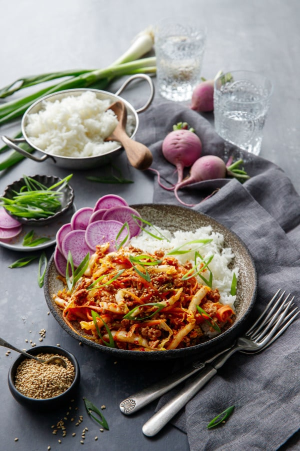 Spicy Korean Egg Roll Bowls with a bowl or rice and purple radishes