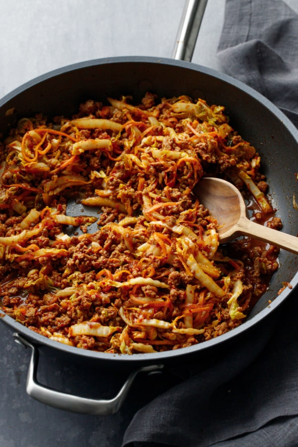 Stir fried cabbage, carrot and ground pork in a nonstick skillet.