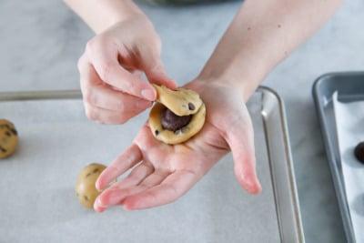 Sandwiching the ganache between two pieces of dough.