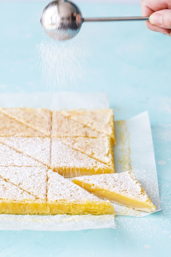 Dusting Meyer Lemon Bars with powdered sugar