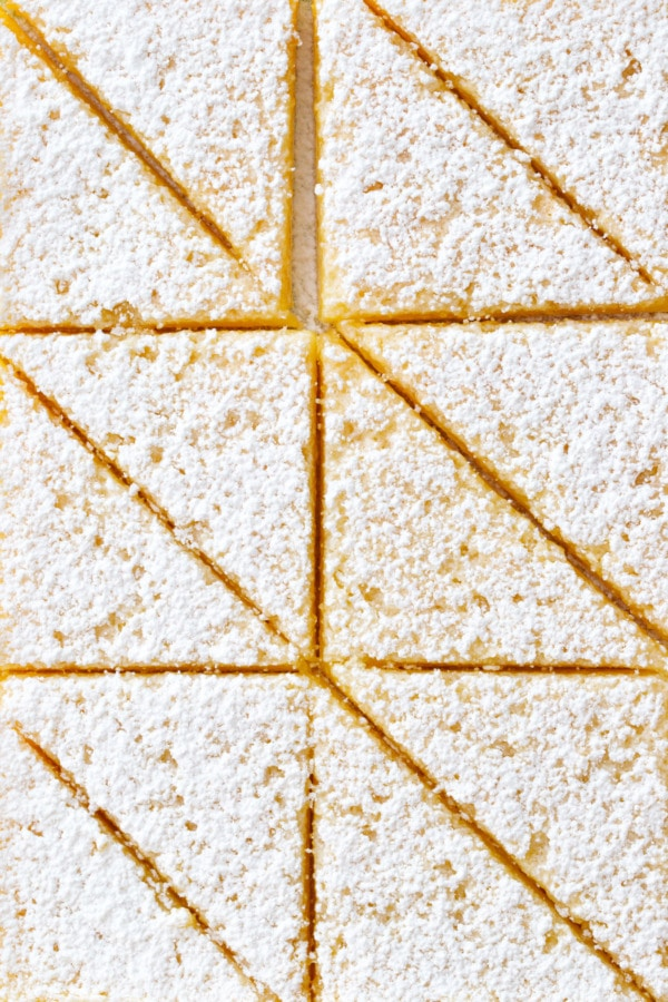 Meyer Lemon Bars sliced into triangles.