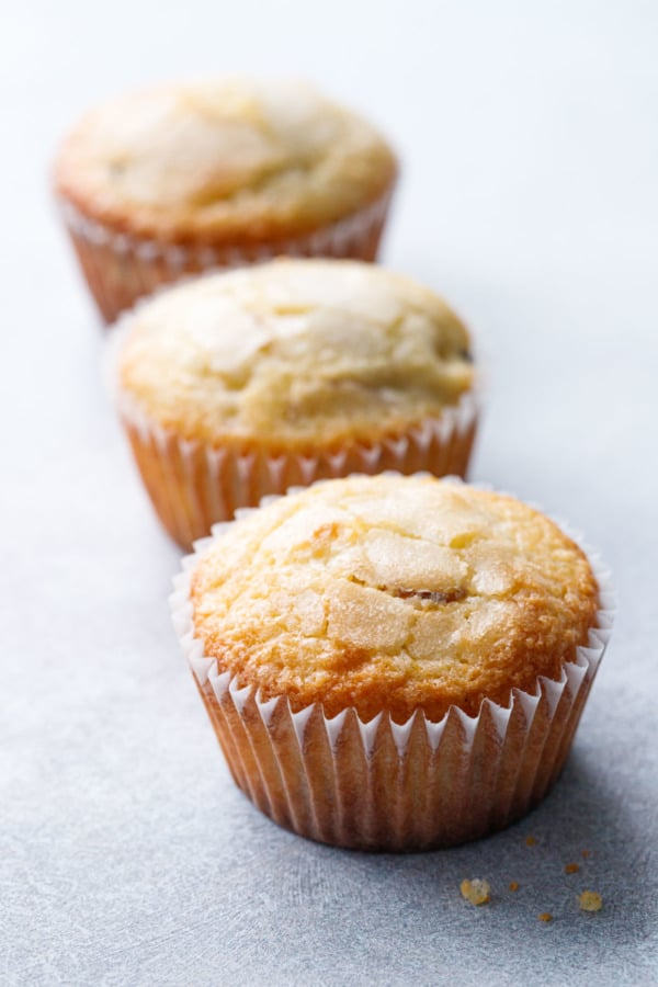 Row of three Sourdough Muffins on a gray background