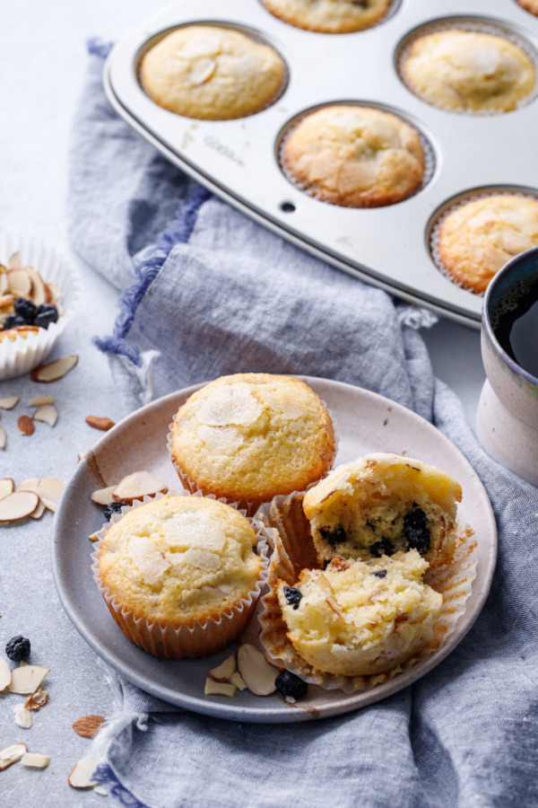 Plate of Sourdough Muffins with Dried Blueberries and Almonds, linen napkin and muffin tin