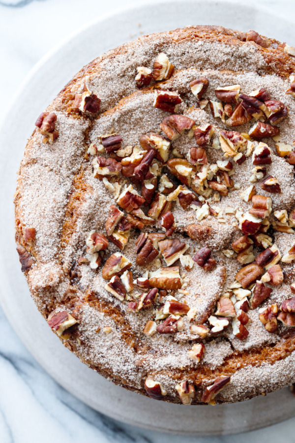 Overhead detail of round coffee cake with sugar and pecan topping