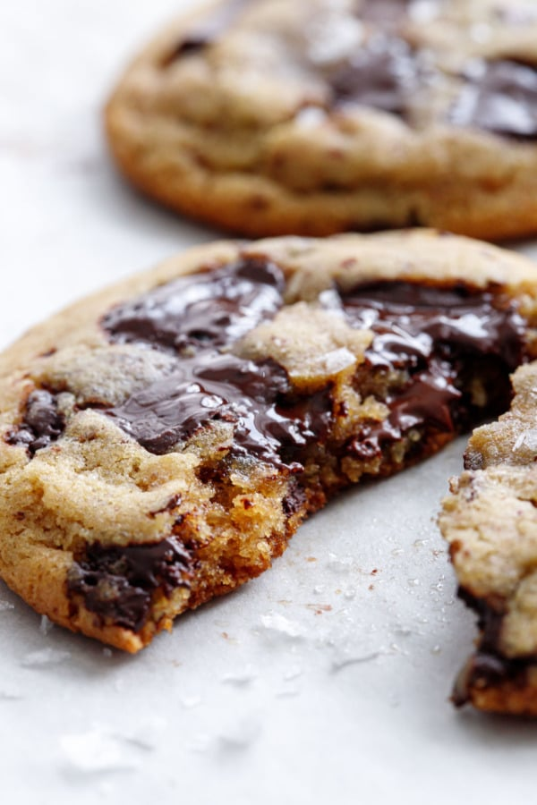Closeup of half a cookie showing the texture and gooey chocolate puddles